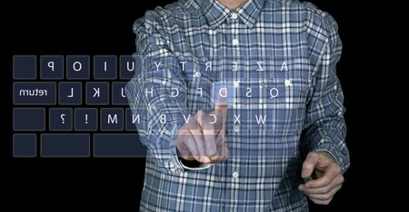 Hand's man touching a touchscreen interface with azerty keyboard photo