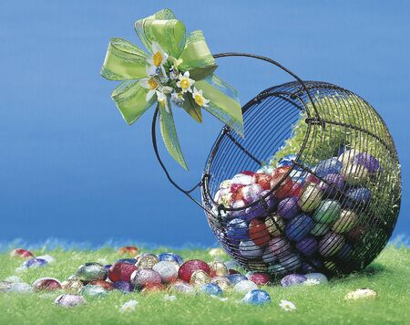 Easter colored eggs in the basket Stock Photo - 12506744