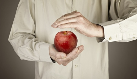 human hands protecting apple Stock Photo - 16432341
