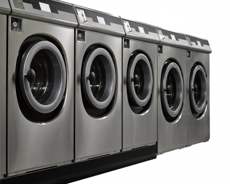 A row of industrial washing machines in a public laundromat Stock Photo - 16924886