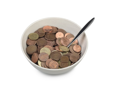 bowl of european money with spoon (clipping path) photo