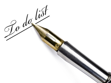 signer: Pen writing a to-do list on white