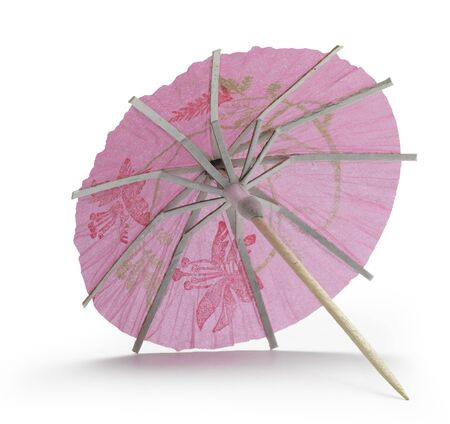 rose cocktail umbrella on white background