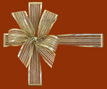 gold gift ribbon isolated on red background Stock Photo - 17363860