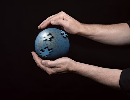Man holding a glowing earth globe in his hands. Stock Photo - 17388427