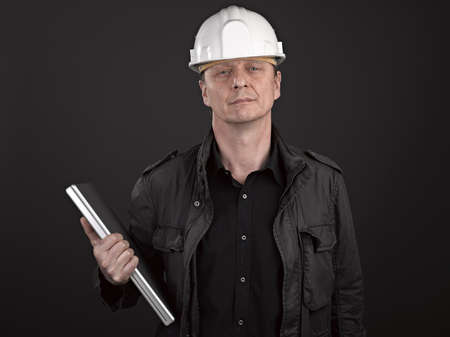 Portrait of a man architect on black background Stock Photo - 17385943