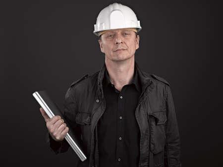 Portrait of a man architect on black background Stock Photo - 17385943