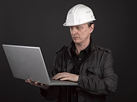 Portrait of a man architect on black background Stock Photo - 17385942
