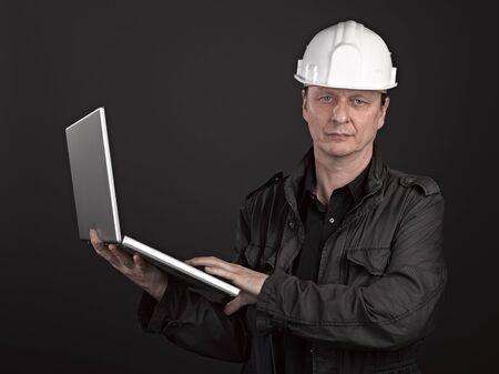 Portrait of man architect on black background Stock Photo - 17385945
