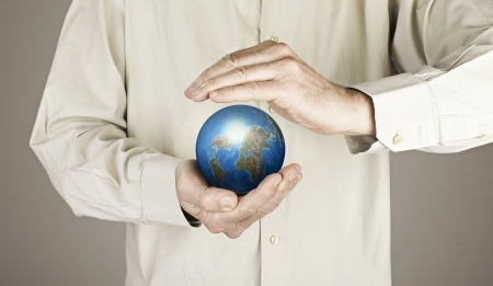 Hands protecting the planet earth Stock Photo - 17388431