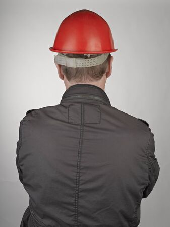 Back of worker man on grey background Stock Photo - 17389167