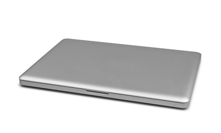 Closed laptop isolated on white, clipping path included Stock Photo - 18243446