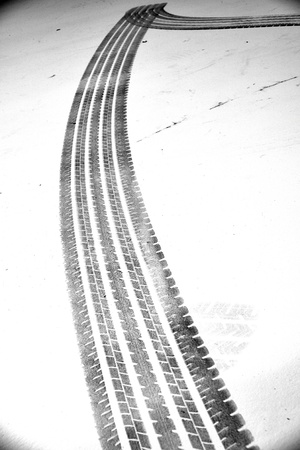 Grunge black tire track on white background photo