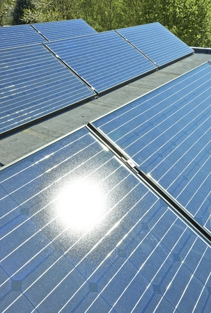 Solar Panels on a Building Roof Stock Photo - 19502776