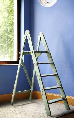 Home improvement with ladder and blue wall