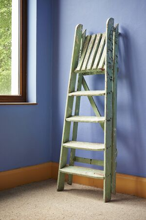 Home improvement with ladder and blue wall photo