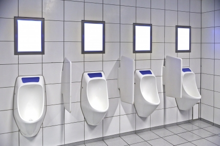 modern restroom interior with urinal row and frame for advertisement