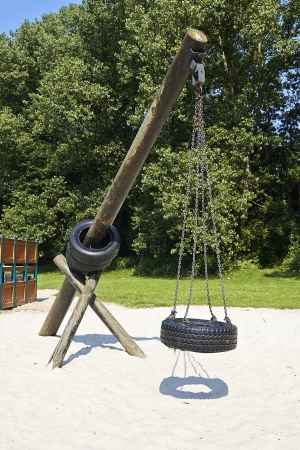 Tire swing hanging in park Stock Photo - 21091237