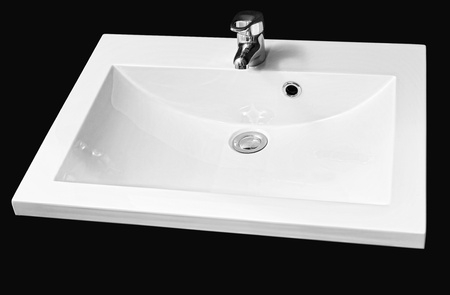 detail shot of white ceramic hand wash basin iisolated on black - clipping path Stock Photo - 22036322
