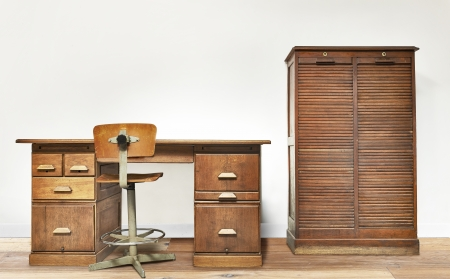 Vintage desk in a room with wooden floor photo