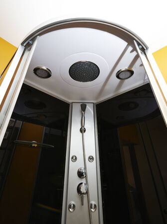 a toilet stool: Interior of shower room with hydro jets Stock Photo