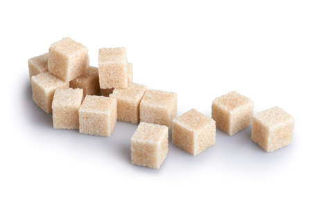 unrefined: Cane sugar cubes on a white background