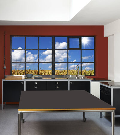 Loft kitchen and windows frames with wheat field in background photo