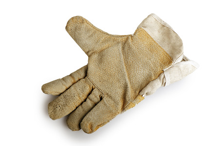 Dirty and well-worn leather work glove on white background  photo