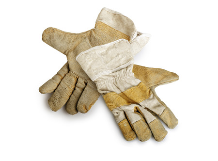 canvass: Dirty and well-worn pair of canvas and leather work gloves on white background