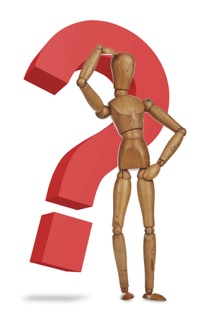 Wooden dummy with a red question mark photo