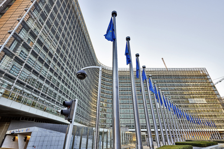 BRUSSELS, BELGIUM - DECEMBER 10  The Berlaymont building anf flags on december 10, 2013 in Brussels  Berlaymont is an office building and it is the headquarters of the European Commission