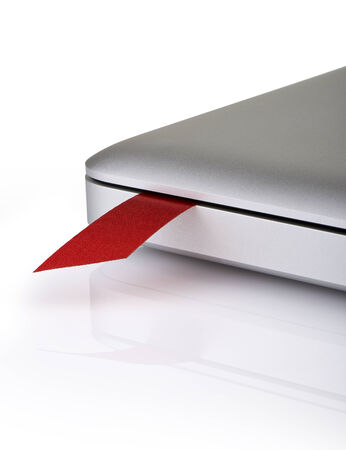 close-up on a red ribbon used as bookmark in a laptop photo