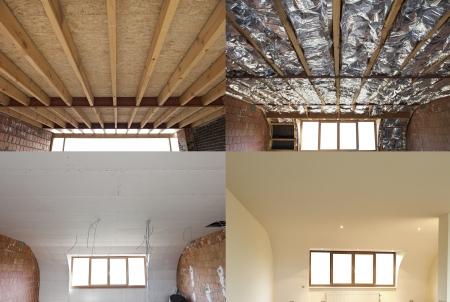 後の建設の乾式壁石膏ボードの前に家の傾斜天井に取り付けられている roofFibreglass の絶縁材の木製フレームの構造