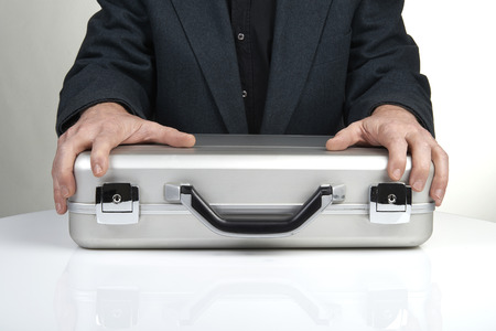 business person holding a briefcase photo