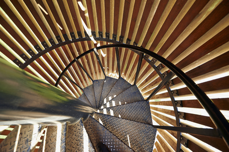 Metal modern spiral staircase details with wooden structure photo