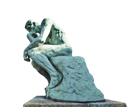 The Thinker Statue by the French Sculptor Rodin on white photo