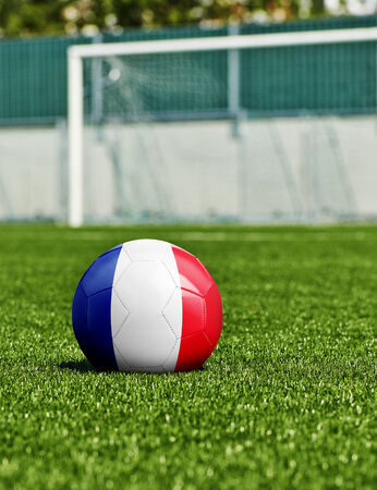 Soccer Ball with France Flag on the grass in stadium photo