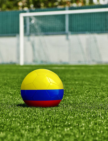 Soccer Ball with Columbia Flag on the grass in stadium photo