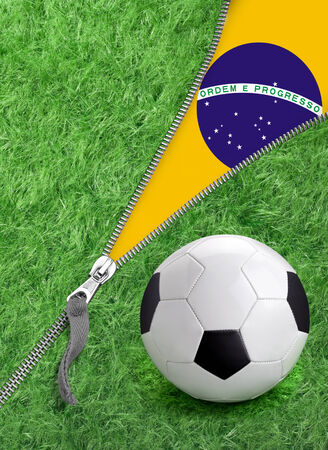 Zipper with Grass and football ball on Brazil flag for the opening. photo