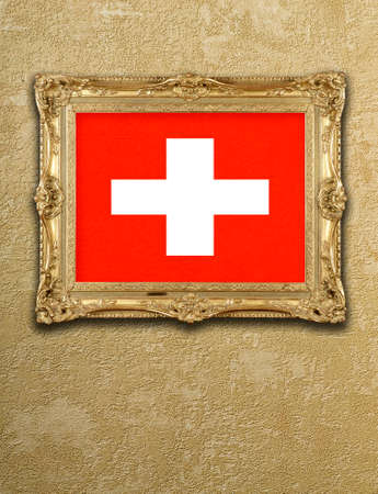 Flag from Switzerland exposition in gold frame on textured wall photo