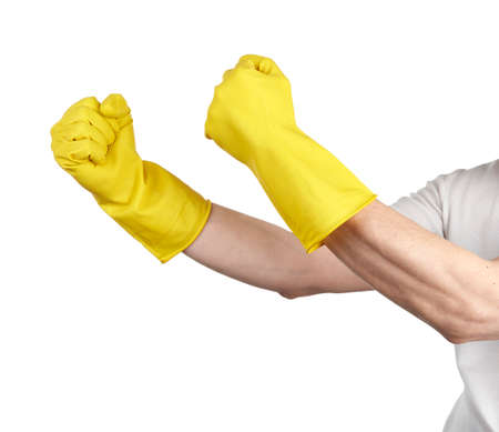Hands of a house man in yellow rubber gloves gesturing fist isolated on white background photo