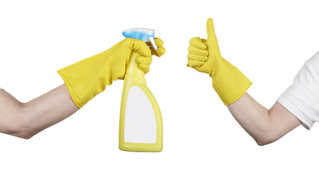 hand with yellow cleaning product glove showing thumb up. Cleaning's done
