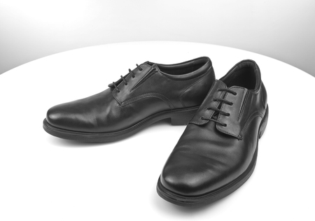 shoestrings: Pair of black male classic shoes on white table