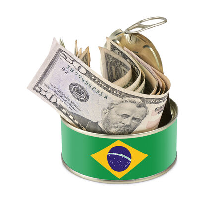 Tin can with US dollars isolated on white background - clipping path - Brazil flag as label photo