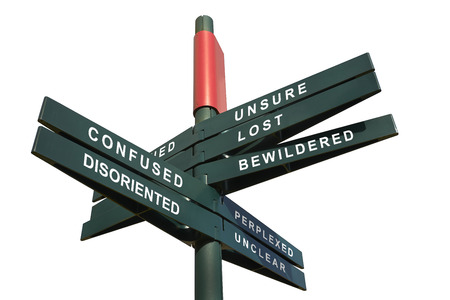 disoriented and Confused Signpost against cloudy sky - clipping path for isolated the panels Stock Photo
