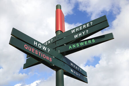 Questions and Answers signpost against cloudy sky - clipping path for isolated the panels photo