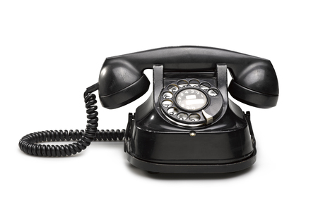 Office: old and vintage telephone Black on white background photo