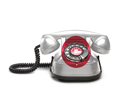 Office: old and vintage telephone with the union Japan on white background