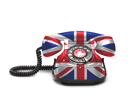 Office: old and vintage telephone with the union jack flag on white background Standard-Bild