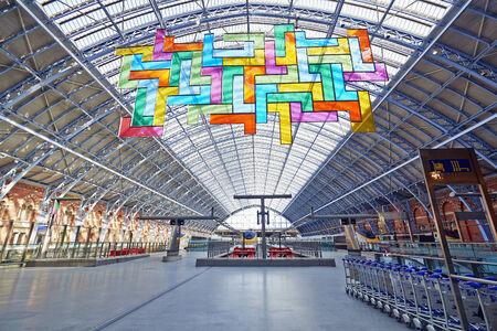 eurostar: LONDON - JUNE 8.  Restored and redeveloped St Pancras International rail station and the Chromolocomotion by David Batchelor; June 7, 2014 in London, UK.